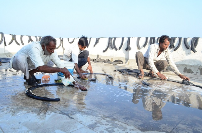 Ecowings Workers Washing Upcycled Rubber Tires