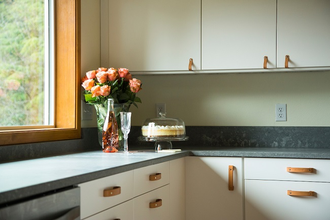 Upcycled Ikea Kitchen Cabinets with New Leather Handles