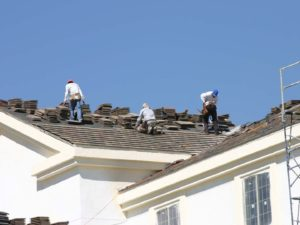 Roofers Placing New Roof on Home