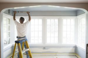 Painter Painting a White Room in House