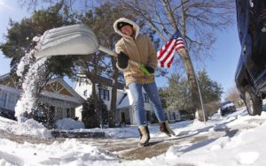 Texas Power Outage Shoveling Snow